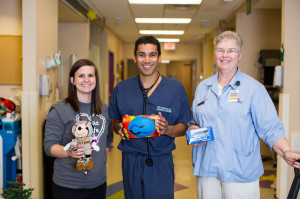 Dr. Samaddar in the Pediatric Emergency Department with  Pediatric Child Life Specialist and Volunteer.