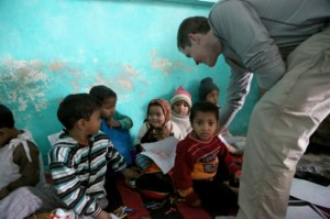 john-with-slum-school-children